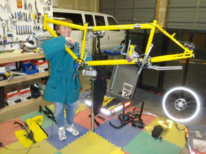 Assembling a bike at a bike stand.